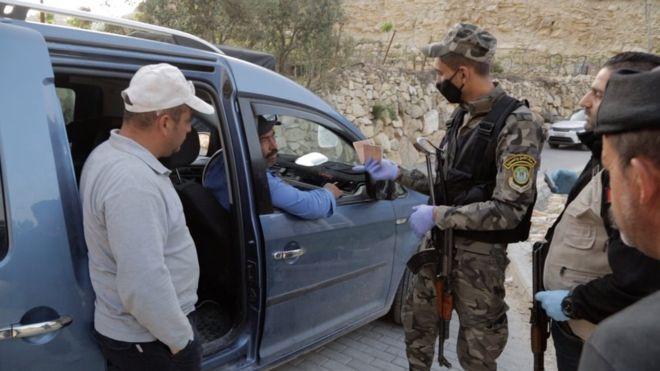 Palestinians working in Israel face coronavirus dilemma