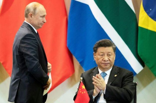 Putin, Xi slam attempts to blame China for late virus response