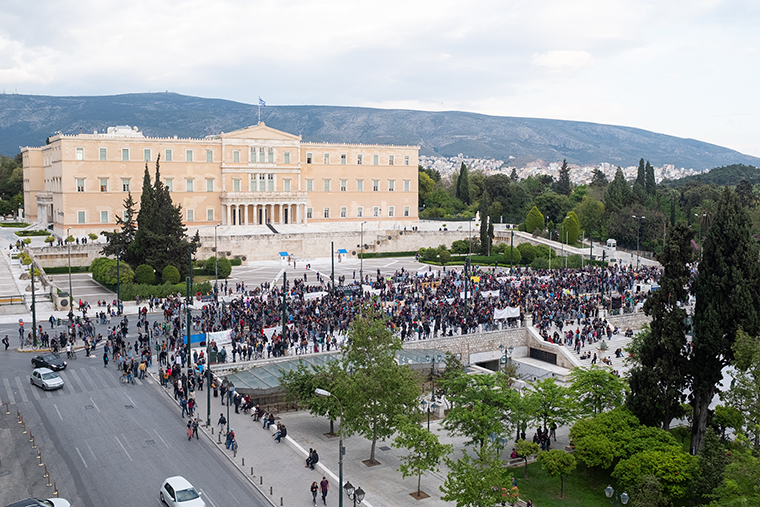 Environmentalists in Greece protest outside parliament after country eases some restrictions