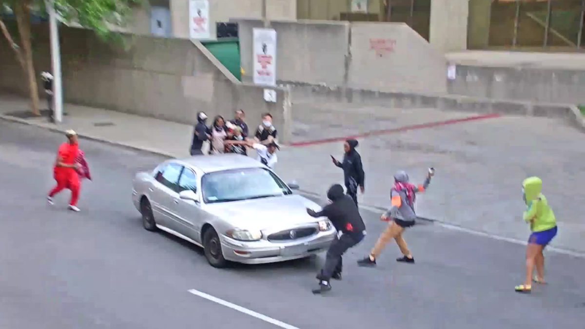A protester pulled a gun on the driver of a speeding car in Louisville, Kentucky, police say