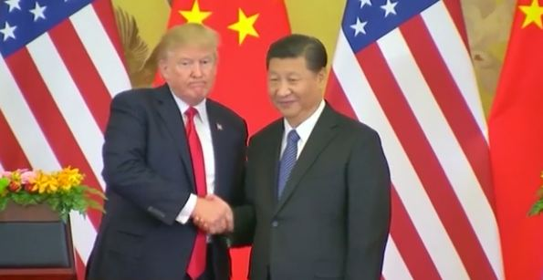 Trump bans Americans from investing in Chinese firms he claims have ties to the military