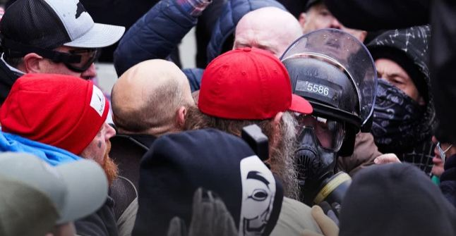Video shows police officer assaulted by mob of Capitol rioters